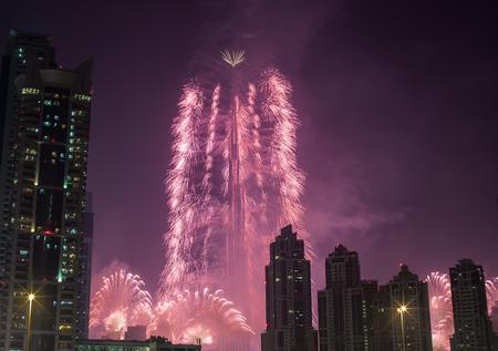 over one million people watching new year fireworks show series at world\'s tallest tower Burj Khalifa in Dubai United Arab Emirates UAE
