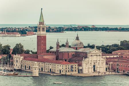 Aerial view of the Venice city scape with Basilica Di San Giorgio Maggiore and grande canal. Venice Italy