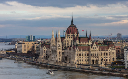 BUDAPEST, HUNGARY - JANUARY 16, 2019 : Gothic architecture of famous Hungarian Parliament building exterior view at winter time