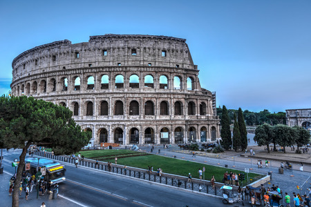 A view of Colloseum and city traffic at summer time Rome Italy