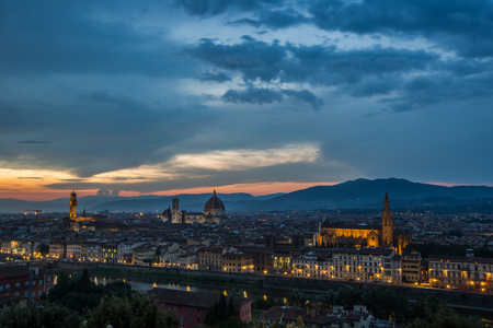 Aerial view of the Beautiful city Florence with historic buildings and river at evening time