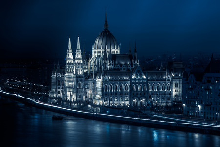 Hungarian Parliament building Night panaroma from the Danube river at winter time. Stock Photo