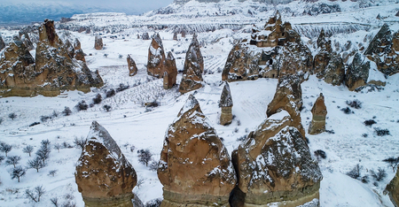 Aerial view Valley of love covered by snow at winter time Cappadocia. Turkey Imagens