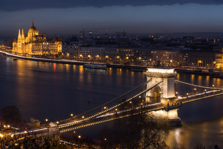 BUDAPEST, HUNGARY - JANUARY 17, 2019 : Aerial view of buildings, Danube river, Parliament building and and Chain bridge in old city Budapest at winter time