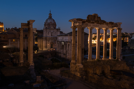 A view of antique Roman Forum (Foro Romano) Rome city, Italy at sunset time