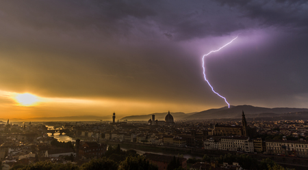 Lightning strikes over Florence city skyline. Aerial view of Florence cityscape with old Duomo, Palazzo vecchio and Arno river Florence, Italy Stock fotó