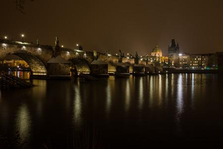 Famous Historic Charles bridge and vltava river in Prague Czech republic at winter night Imagens