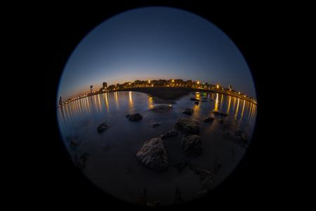 Barcelona beach coastline at sunset time with shot fisheye lens