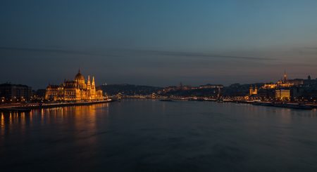 A view of Budapest city scape Hungarian Parliament building and Danube river at night.