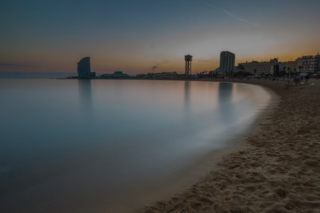 Scenic view of calm sea and building in Barcelona, Spain
