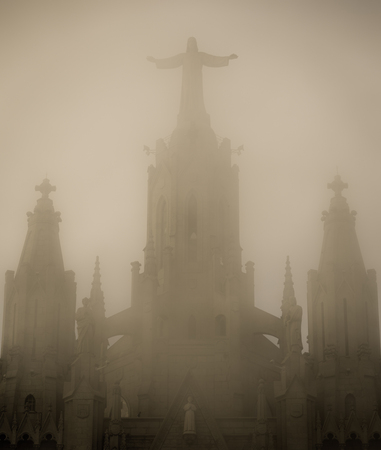 A view of Central entrance of famous temple expiatori del sagrat, barcelona, spain on the foggy autumn day