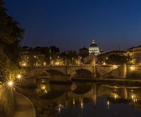 A view of Castel Santangelo fortress and bridge  in Rome, Italy at night time