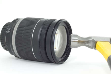A hammer about to smash a delicate expensive camera lens