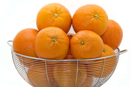 florida citrus: Delicious ripe Florida oranges stacked up on a white plate
