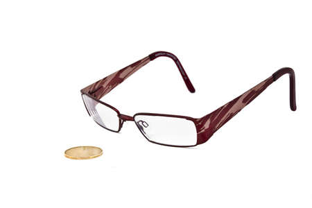 pennypinching: A  pair of eye glasses keeping a close eye on a canadian dollar bill.