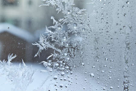 crystal background: Ice crystals on a glass window of a home in Regina Canada, during the cold winter season Stock Photo