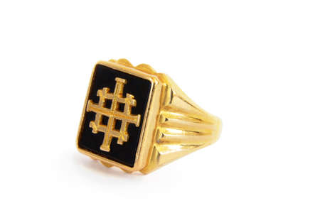 A traditional Ethiopian hand made mens ring with a cross in the middle with onyx background