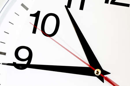 clock: Photo showing the passing of one secnods on a wall clock Stock Photo