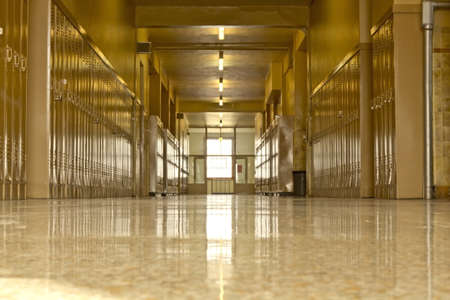 hallway: An empty high school corridor with a bright light at the end of the hallway
