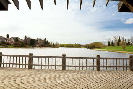 porch scene: a tranquil scene from the deck overlooking a small body of water Stock Photo
