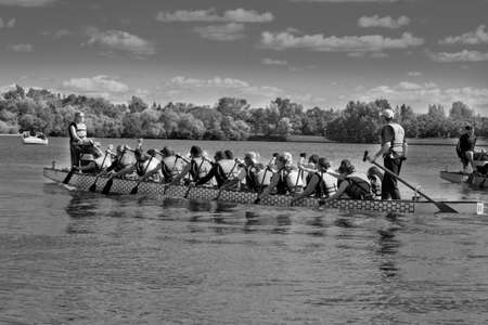 A team of dragon boat racers paddling their boat
