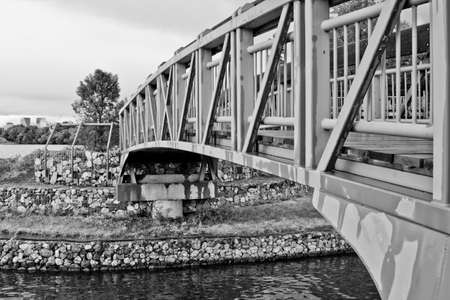 A small bridge for pedestrians crossing Wascana Lake in Regina, Canada