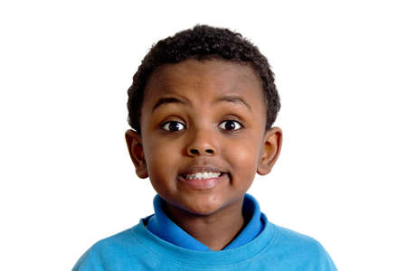 expression facial: Portrait of a young Ethiopian child with his eyes wide open with excitement Stock Photo