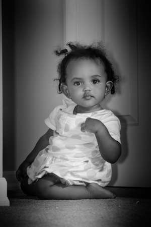 Portrait of a beautiful little girl looking into the camera. photo
