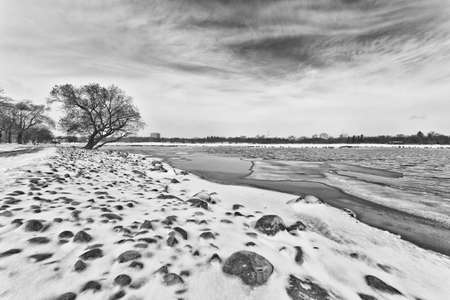Wascana lake in Regina, Saskatchewan beginning to freeze during the cold winter days in November photo