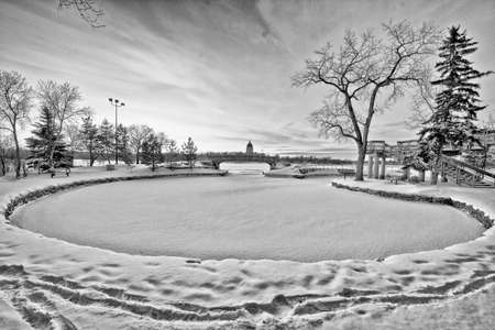 Wascana lake in Regina, Saskatchewan frozen during the cold winter days in November