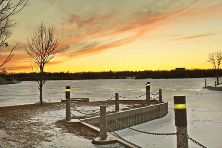 regina: Wascana lake frozen on a cold November day during winter in Regina, Canada. Stock Photo