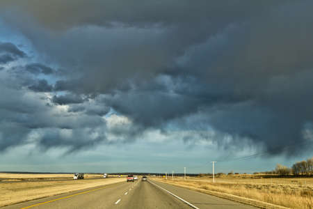 Dark clouds in the sky over highway one in Saskatwan, Canada photo