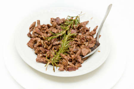 ed: Tibs, Traditioal Ethiopian cusine which is sautéed meat and onions served with rosemerry leaves