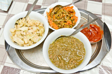 ethiopian: Traditinal Ethiopian alica wot  curry stew  served in a bowl