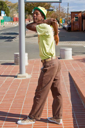 moves: Soweto, South Africa- July 29 - A street performer demonstrates several acrobatic moves showing his body?s unbelievable flexibility near  Mandelas house on July 29, 2012 in Soweto, South Africa Editorial