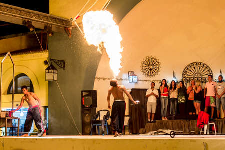Spectacular show at an outdoor stage in Hammamet, Tunisia, where Local talent showcase their extraordinary ability to breathe fire like the mystical fire breathing dragons.