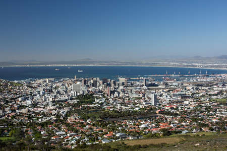 capetown: Aerial view of the city of Capetown showing the densely packed buildings and clear blue water in the background