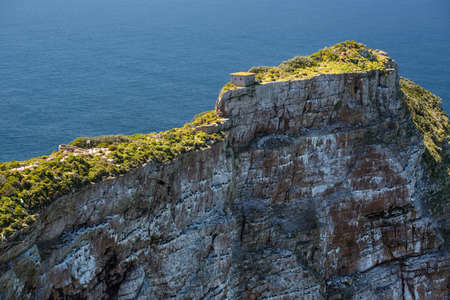 A very steep cliff at Cape Point, the place where the Atlantic Ocean meets Indian Ocean