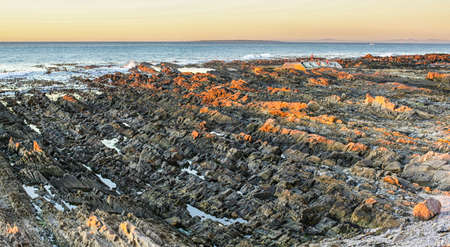 shores: The beautiful rocky shores of the  Atlantic ocean in Cape Town, South Africa Stock Photo