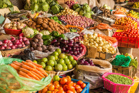 Colorful fruits and vegetables colorfully arranged at a local fruit and vegetable market in Nairobi, Kenya