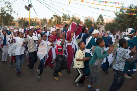 ADDIS ABABA, ETHIOPIA– JANUARY 18: A large crowd of people sing and chant while accompanying the Tabot, a model of the arc of covenant, during a colorful procession which is part of Timket celebrations of Epiphany, commemorating the baptism of Jesus in