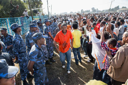 ababa: ADDIS ABABA, ETHIOPIA– JANUARY 19: Holy water sprayed on thousands of people attending Timket celebrations of Epiphany, commemorating the baptism of Jesus in the river of Jordan, on January 19, 2013 in Addis Ababa. Editorial