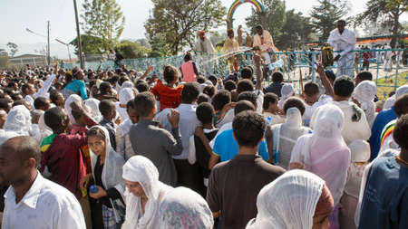 ADDIS ABABA, ETHIOPIA– JANUARY 19: Holy water sprayed on thousands of people attending Timket celebrations of Epiphany, commemorating the baptism of Jesus in the river of Jordan, on January 19, 2013 in Addis Ababa. Stock Photo - 17464970