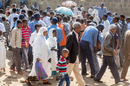 pat down: ADDIS ABABA, ETHIOPIA– JANUARY 19: The local police conducting a pat-down search on the hundreds of thousands of people attending Timket celebrations of Epiphany, commemorating the baptism of Jesus in the river of Jordan, on January 19, 2013 in Addis Ab Editorial