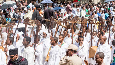 ADDIS ABABA, ETHIOPIA– JANUARY 19: Church members carry traditional string based instrument called Begena while accompanying the Tabot, a model of the arc of covenant, during a colorful procession which is part of Timket celebrations of Epiphany, commem Stock Photo - 17464962