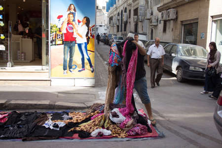 Local street market at the heart of the city of Tunis where the residents, come for great bargains for their day to day shopping Stock Photo - 17464939