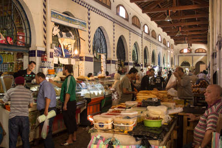 Local street market at the heart of the city of Tunis where the residents, come for great bargains for their day to day shopping Stock Photo - 17464971