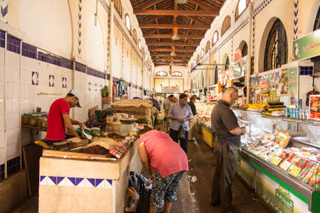Local street market at the heart of the city of Tunis where the residents, come for great bargains for their day to day shopping Stock Photo - 17464972