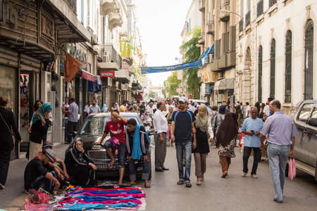 Local street market at the heart of the city of Tunis where the residents, come for great bargains for their day to day shopping Stock Photo - 17464370
