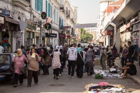 Local street market at the heart of the city of Tunis where the residents, come for great bargains for their day to day shopping Stock Photo - 17464977